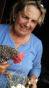 Harriet and one of her chickens. It lays blue eggs!